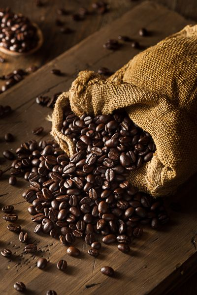 Organic Dry Roasted Coffee Beans on a Background